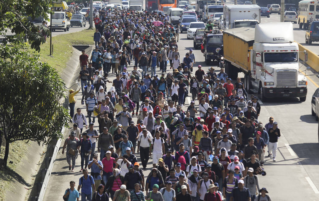 Migrants from El Salvador start on their way to the United States, in San Salvador, El Salvador, Wednesday, Oct. 31, 2018. A third group of migrants from El Salvador had already made it to Guatema ...