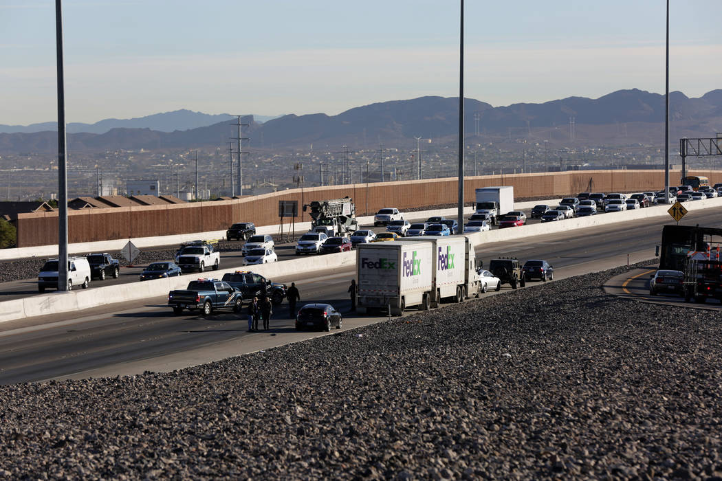 Eastbound lanes of the 215 Beltway are shut down by the Nevada Highway Patrol after a female juvenile jumped from the 215 overpass at Stephanie and was struck by a FedEx tractor trailer on Thursda ...
