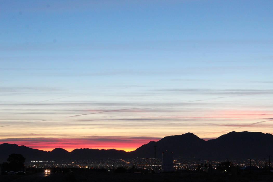 The sun peeks over the horizon on Thursday, Nov. 1, 2018 in the central Las Vegas Valley. (Max Michor/Las Vegas Review-Journal)