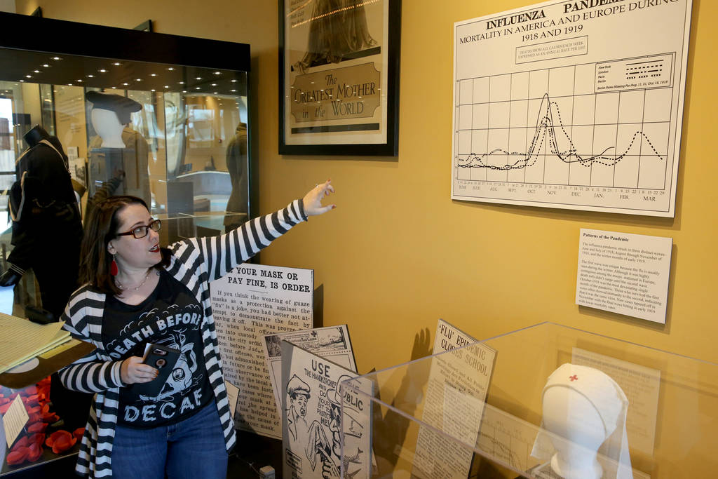 Nevada State Museum Administrative Assistant Ilana Short talks about a section of the new World War I exhibit dedicated to the 1918 worldwide flue pandemic in the museum at the Las Vegas Springs P ...