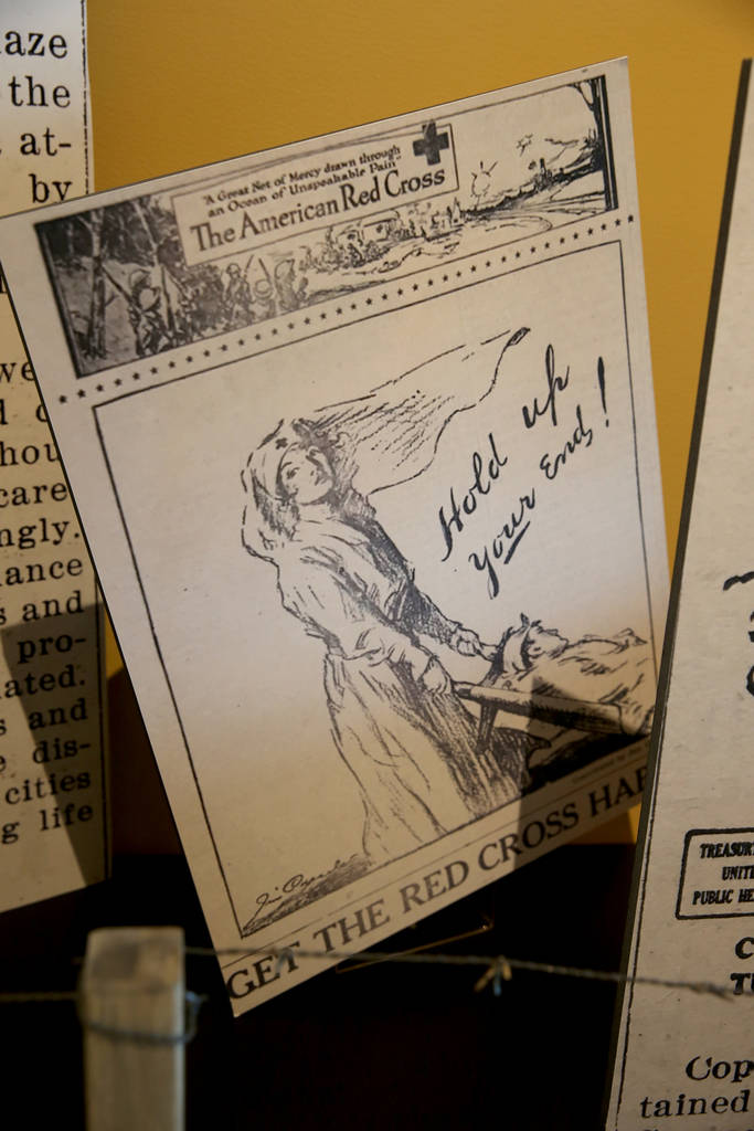 A poster in a section of the new World War I exhibit dedicated to the 1918 worldwide flue pandemic at the Nevada State Museum at the Las Vegas Springs Preserve in Las Vegas Tuesday, Oct. 30, 2018. ...
