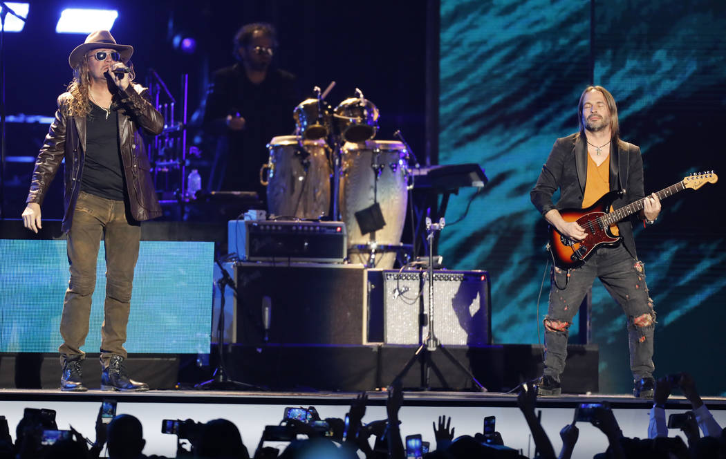 Fher Olvera, left, and Sergio Vallin, of Mana, perform at the Billboard Latin Music Awards at the Mandalay Bay Events Center on Thursday, April 26, 2018, in Las Vegas. (Photo by Eric Jamison/Invis ...