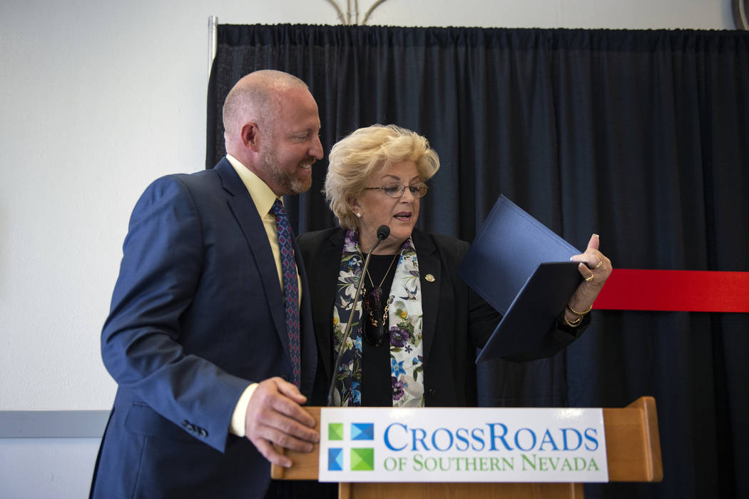 Las Vegas Mayor Carolyn Goodman presents a certificate to Jeff Iverson, founder of CrossRoads of Southern Nevada, at the CrossRoads of Southern Nevada ribbon cutting ceremony at its new facility i ...