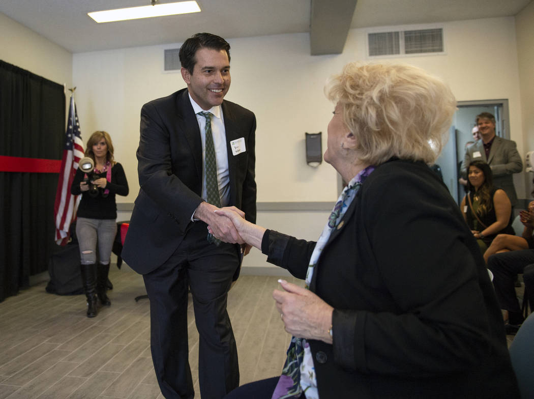 Nevada Assistant Attorney General Brin Gibson shakes the hand of Mayor Carolyn Goodman as he walks up to speak at the CrossRoads of Southern Nevada ribbon cutting ceremony at its new facility in L ...