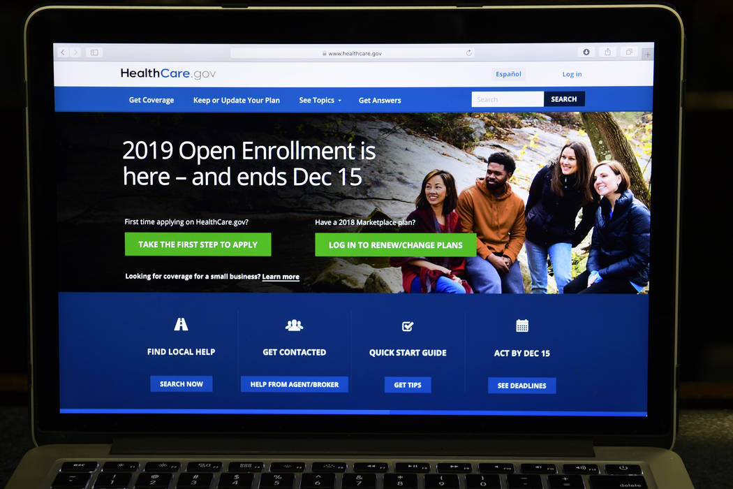 The federal website where consumers can sign up for health insurance under the Affordable Care Act is shown on a computer screen in Washington on Thursday. (AP Photo/Susan Walsh)