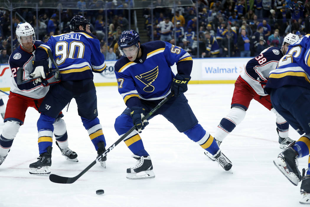 St. Louis Blues' David Perron handles the puck during the second period of an NHL hockey game against the Columbus Blue Jackets Thursday, Oct. 25, 2018, in St. Louis. (AP Photo/Jeff Roberson)