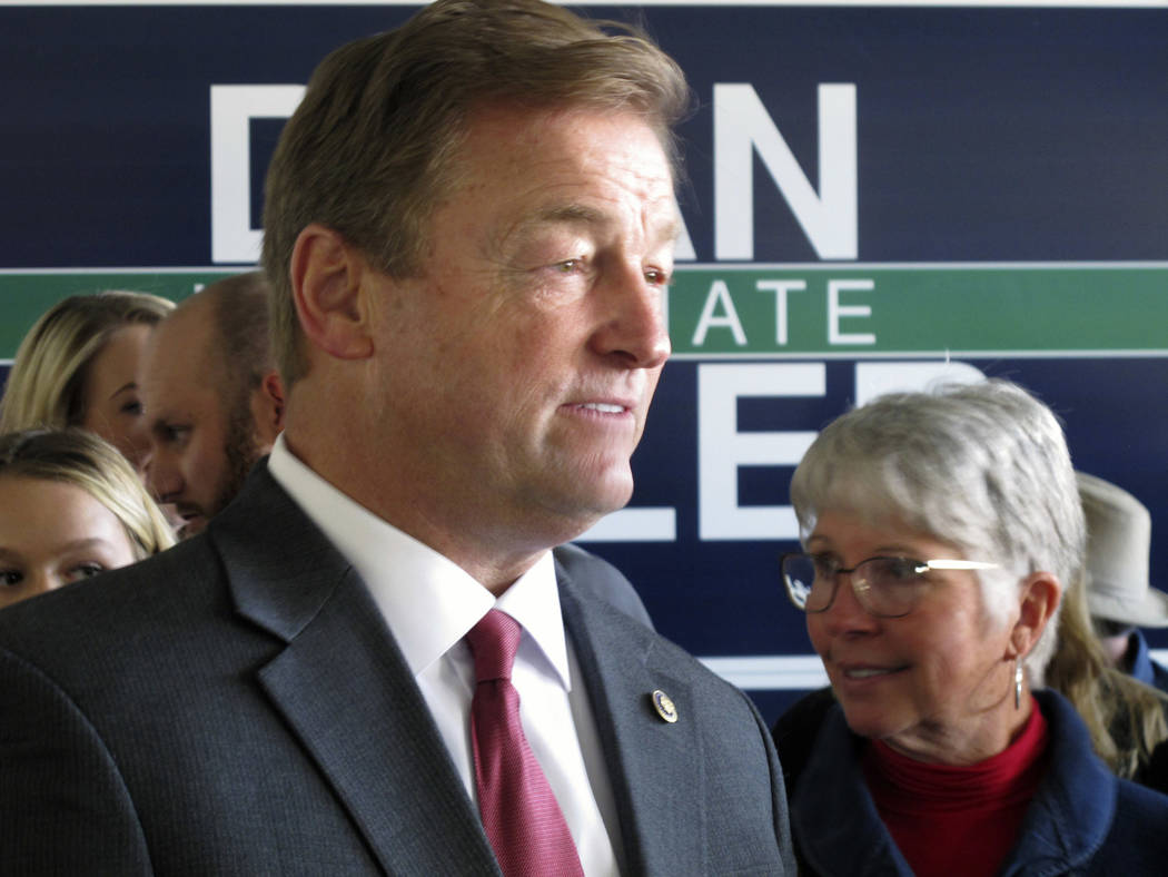 Nevada Republican Sen. Dean Heller listens to supporters before a joint appearance with Ivanka Trump, at the GOP field office in Reno, Thursday, Nov. 1, 2018. Ivanka Trump praised Heller for his r ...