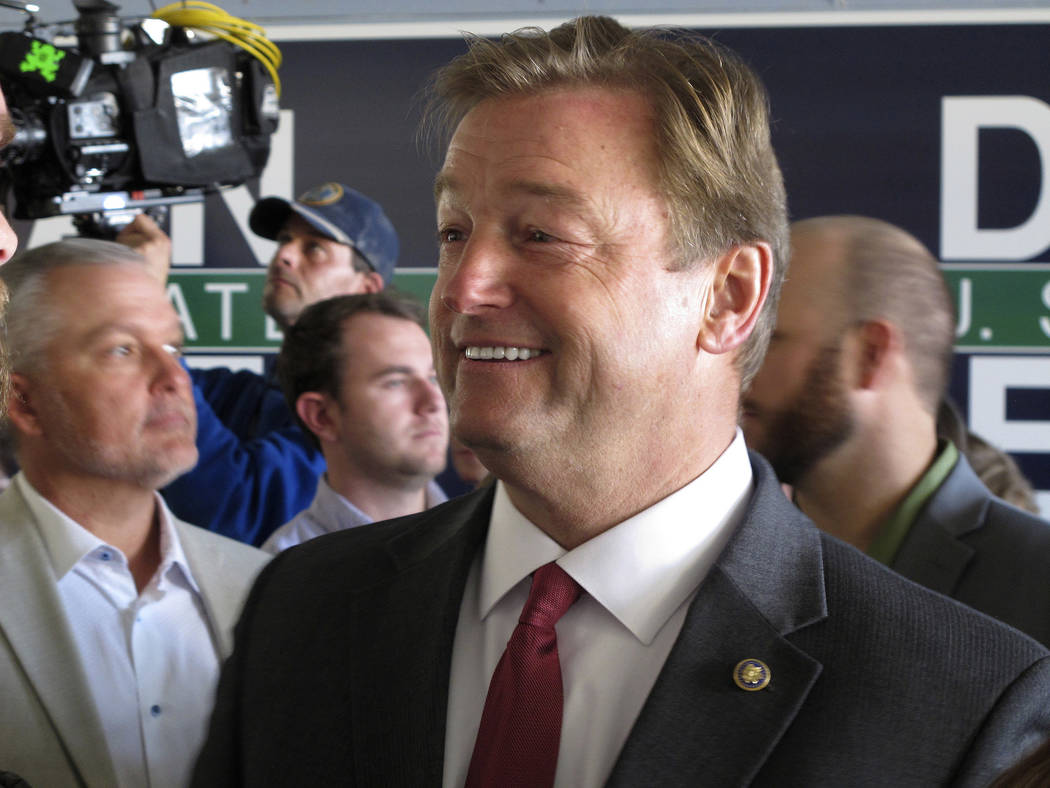 Nevada Republican Sen. Dean Heller talks to supporters before a joint appearance with Ivanka Trump, at the GOP field office in Reno, Thursday, Nov. 1, 2018. She said she's confident he'll win his ...