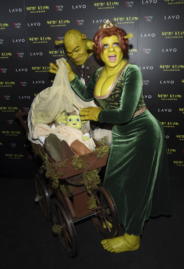 Model and television personality Heidi Klum, right, and boyfriend Tom Kaulitz dressed as Shrek and Princess Fiona arrive at her 19th annual Halloween party at Lavo New York on Wednesday, Oct. 31, ...