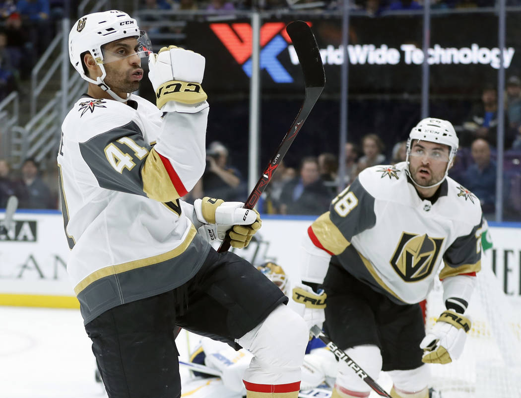 Vegas Golden Knights' Pierre-Edouard Bellemare (41), of France, celebrates after scoring as teammate William Carrier (28) watches during the first period of an NHL hockey game against the St. Loui ...