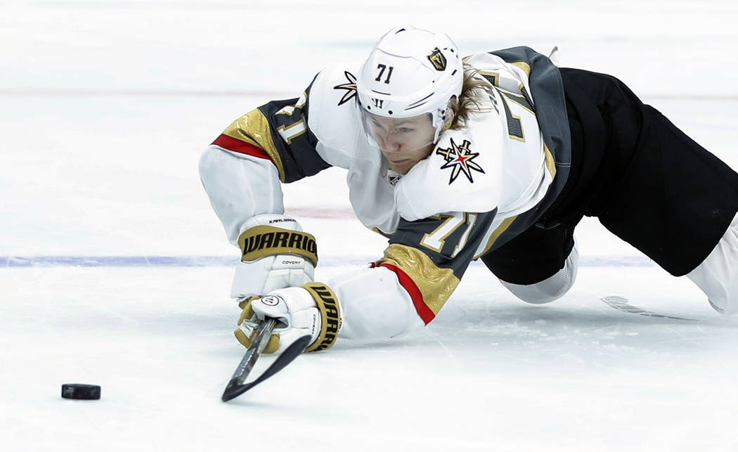Vegas Golden Knights' William Karlsson, of Sweden, reaches for a loose puck during the first period of an NHL hockey game against the St. Louis Blues Thursday, Nov. 1, 2018, in St. Louis. (AP Phot ...