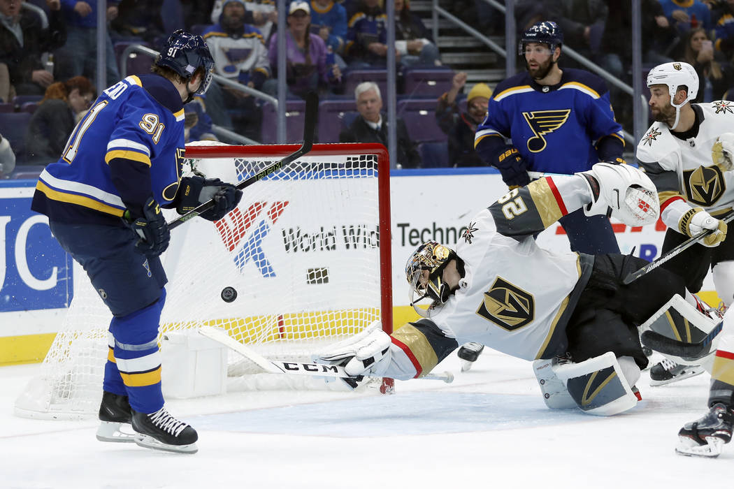 St. Louis Blues' Vladimir Tarasenko, left, of Russia, scores past Vegas Golden Knights goaltender Marc-Andre Fleury (29) during the second period of an NHL hockey game Thursday, Nov. 1, 2018, in S ...