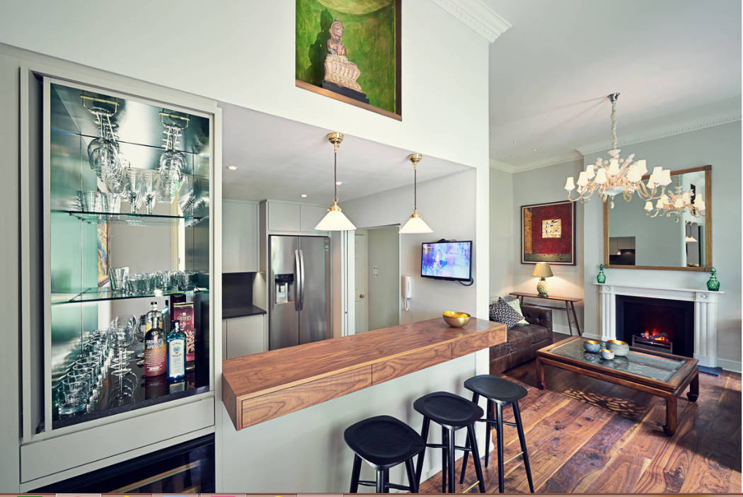 Houzz This is an interesting setup. The countertop does not cover stools, and the stools are backless.