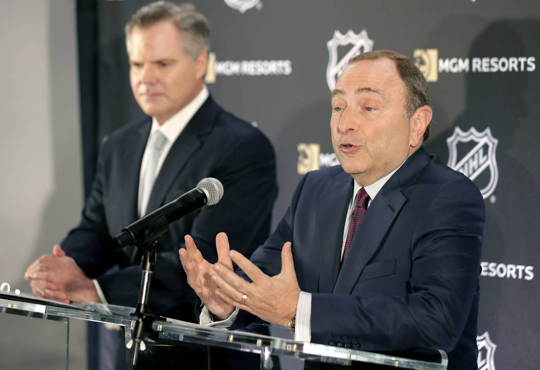 National Hockey League commissioner Gary Bettman, right, speaks while James Murren, CEO of MGM Resorts International, listens during a news conference in New York, Monday, Oct. 29, 2018. The NHL a ...