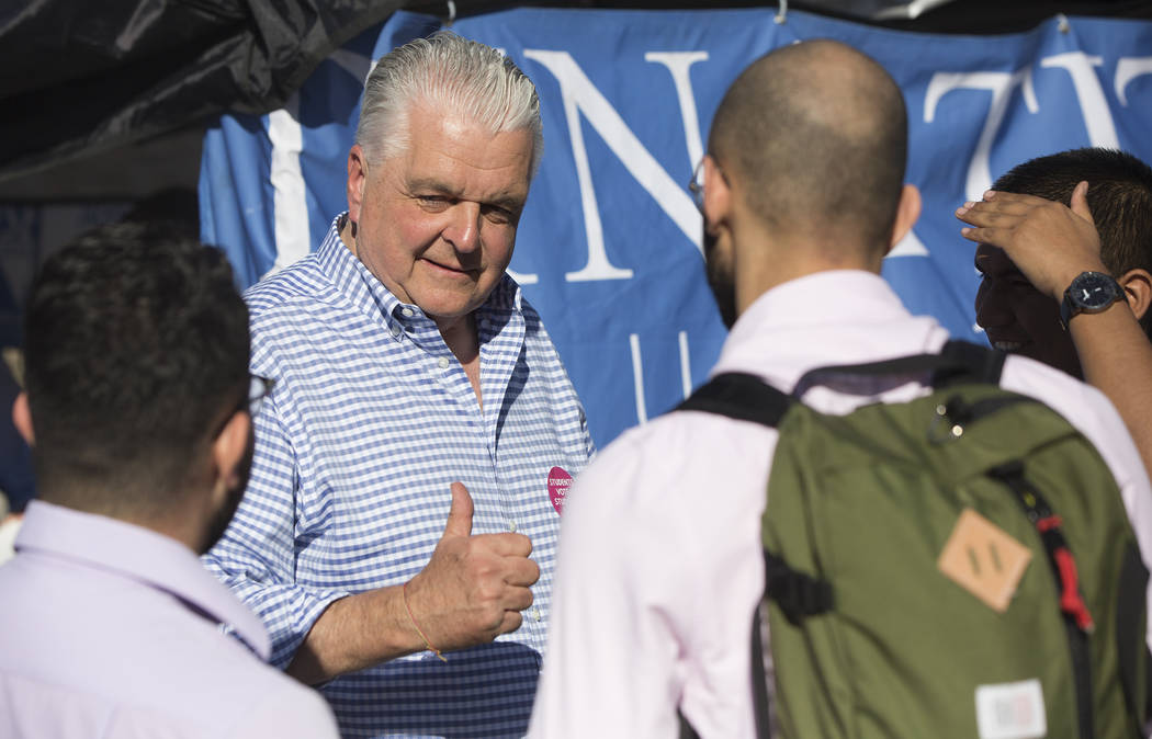 Democratic gubernatorial candidate Steve Sisolak, left, speaks with supporters during a rally hosted by the Nevada State Democratic Party at UNLV on Friday, November 2, 2018, in Las Vegas. Benjami ...