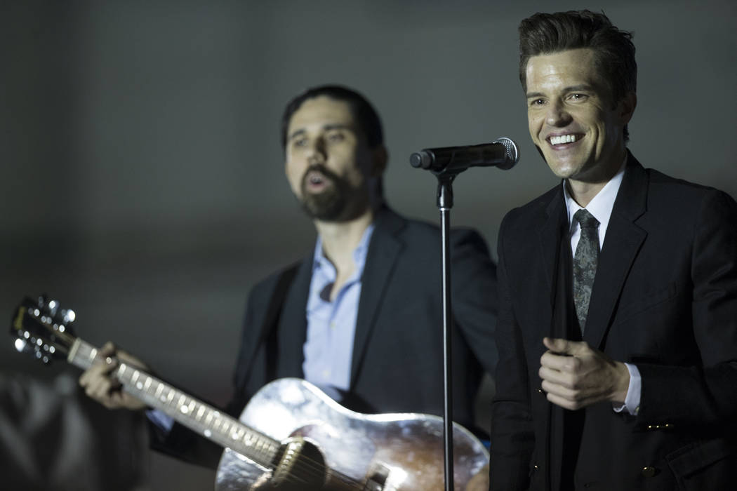 Brandon Flowers, right, frontman for The Killers and a Las Vegas native, performs during a Get-Out-The-Vote rally on Friday, November 2, 2018, at First Friday, in Las Vegas. Benjamin Hager Las Veg ...