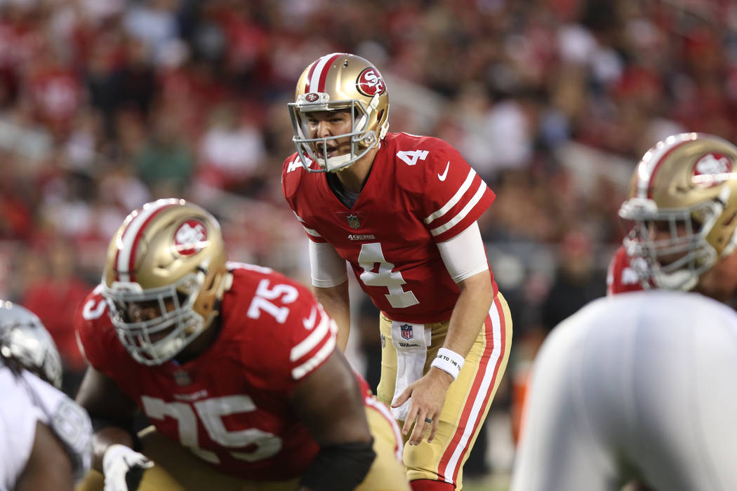 San Francisco 49ers quarterback Nick Mullens (4) prepares to throw the football against the Oakland Raiders during the first half of their NFL game in Santa Clara, Calif., Thursday, Nov. 1, 2018. ...