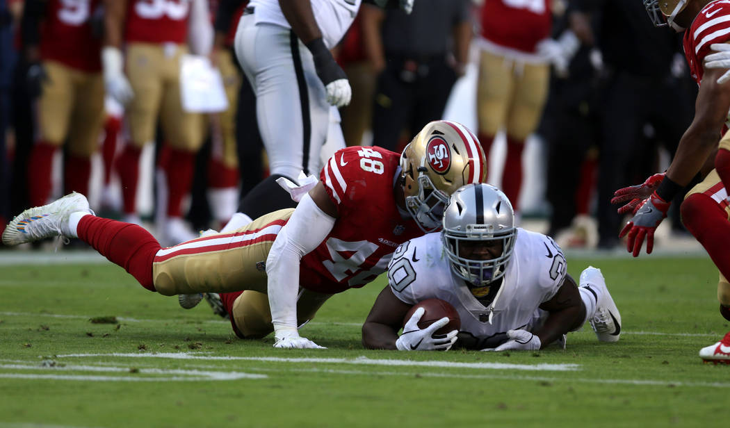 Oakland Raiders running back Jalen Richard (30) is tackled by San Francisco 49ers middle linebacker Fred Warner (48) during the first half of their NFL game in Santa Clara, Calif., Thursday, Nov. ...