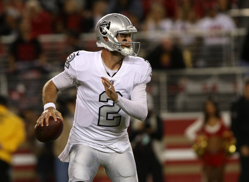 Oakland Raiders quarterback A.J. McCarron (2) looks to pass during the second half of their NFL game against the San Francisco 49ers in Santa Clara, Calif., Thursday, Nov. 1, 2018. Heidi Fang Las ...