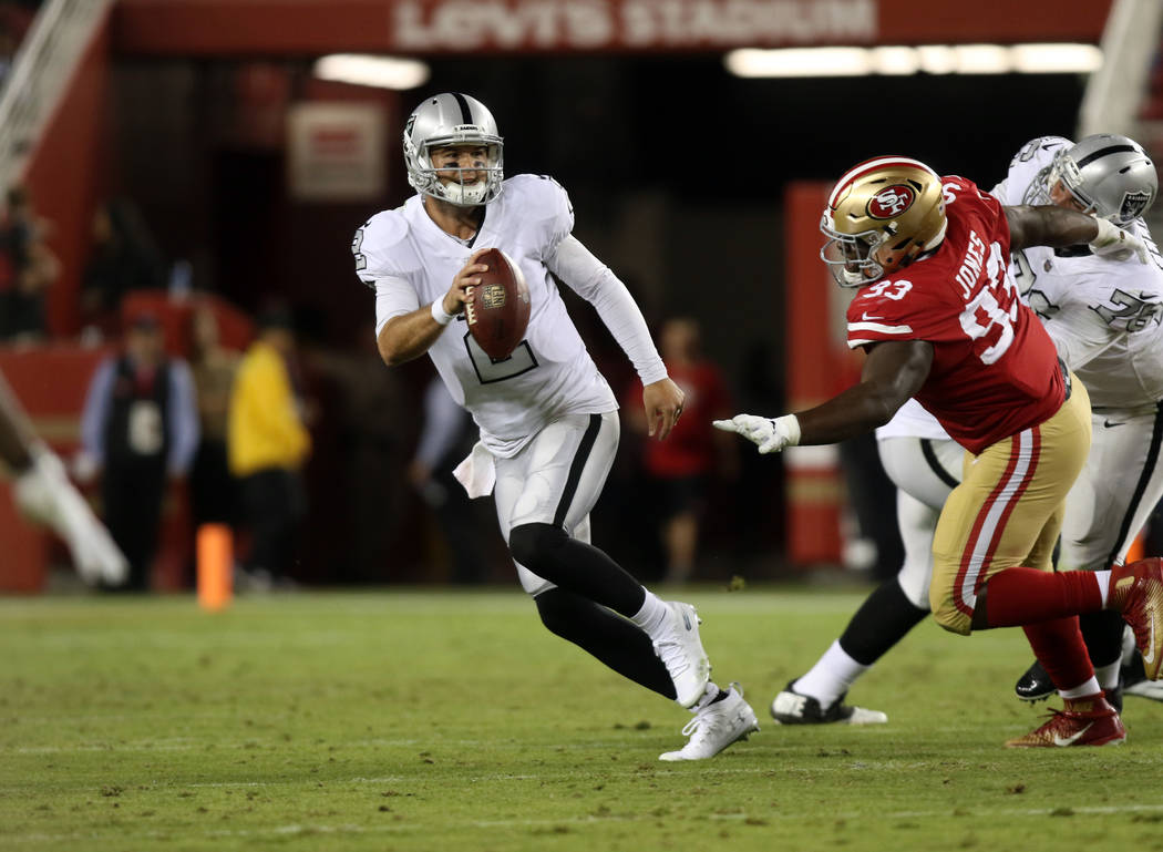 Oakland Raiders quarterback A.J. McCarron (2) is under pressure from San Francisco 49ers defensive tackle D.J. Jones (93) during the second half of their NFL game in Santa Clara, Calif., Thursday, ...