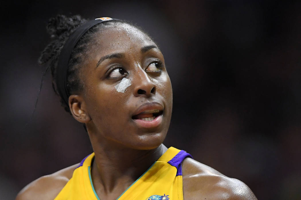 In this Sept. 29, 2017, file photo, Los Angeles Sparks forward Nneka Ogwumike looks toward the scoreboard after receiving treatment for a cut on the face during the second half in Game 3 of the WN ...