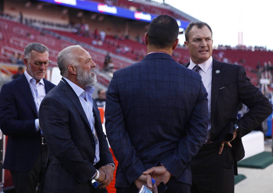 Former UFC owners and Station's Casino CEO Frank Fertitta, left, and director of Red Rock Resorts Inc., Lorenzo Fertitta, center, meet with San Francisco 49ers general manager John Lynch, right, p ...