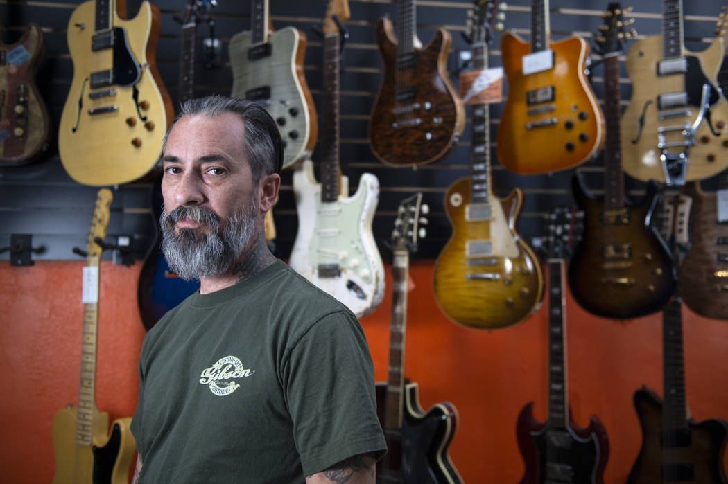 Jesse Amoroso, guitar expert and owner of Cowtown Guitars poses for a portrait inside of his store in Las Vegas, Sunday, Nov. 4, 2018. Caroline Brehman/Las Vegas Review-Journal