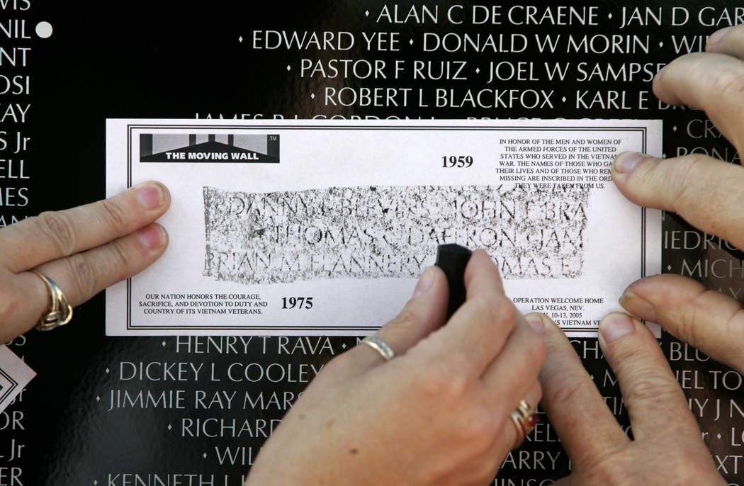 Vietnam Veterans, families and friends made impressions of the names of those that died in Vietnam at the Moving Wall at Main Street Station in 2005. (John Gurzinski/Las Vegas Review-Journal)