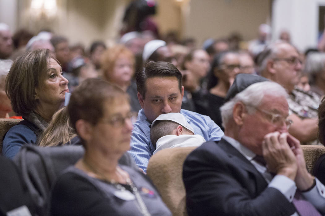 Attendees listen to a speaker during a vigil on Thursday, November 1, 2018, at Temple Beth Sholom in Las Vegas for the 11 people killed at the Tree of Life synagogue in Pittsburgh, Pa., on Saturda ...