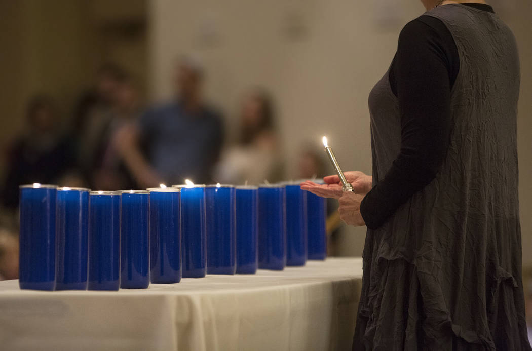 Eleven candles are lit during a vigil on Thursday, November 1, 2018, at Temple Beth Sholom in Las Vegas for the 11 people killed at the Tree of Life synagogue in Pittsburgh, Pa., on Saturday. Benj ...