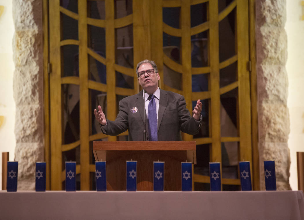 Rabbi Felipe Goodman speaks during a vigil on Thursday, November 1, 2018, at Temple Beth Sholom in Las Vegas for the 11 people killed at the Tree of Life synagogue in Pittsburgh, Pa., on Saturday. ...