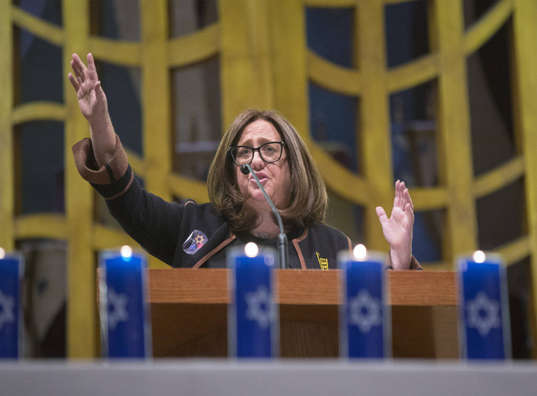 Jolie Brislin, Nevada Regional Director of the Anti-Defamation League, speaks during a vigil on Thursday, November 1, 2018, at Temple Beth Sholom in Las Vegas for the 11 people killed at the Tree ...