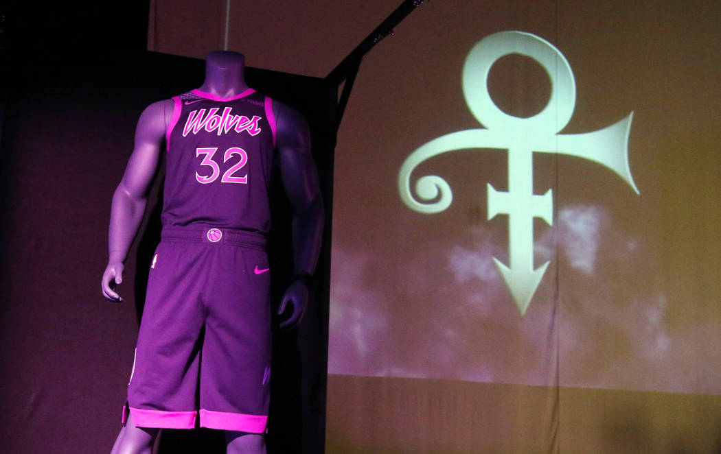 The new City Edition Minnesota Timberwolves uniform, honoring the legacy of the late rock star Prince, is unveiled Thursday, Nov. 1, 2018, in Chanhassen, Minn. The NBA basketball team is scheduled ...