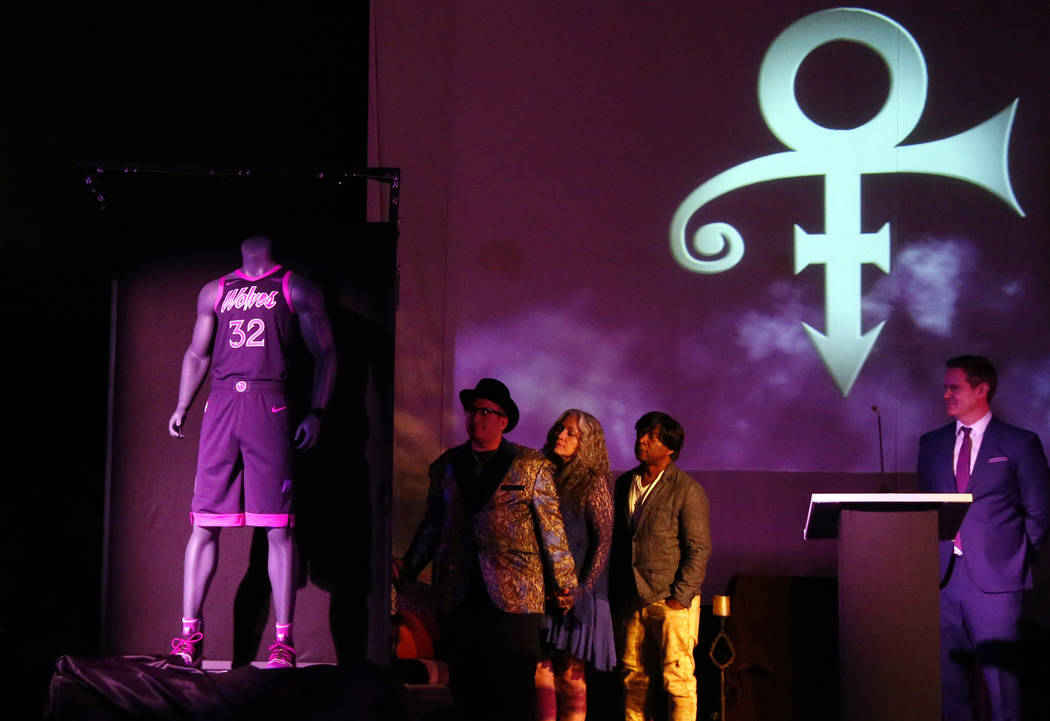Family members, center, of Prince unveil the new City Edition Minnesota Timberwolves uniform, left, honoring the legacy of the late rock star, Thursday, Nov. 1, 2018, in Chanhassen, Minn. The NBA ...