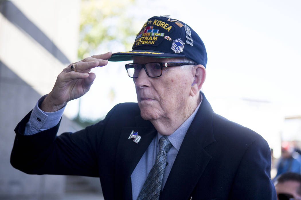 Chester Swafford, a WWII, Korea and Vietnam veteran, stands with other veterans to be honored as the Henderson Symphony Orchestra plays as a tribute for the annual Veterans Day Ceremony held at th ...
