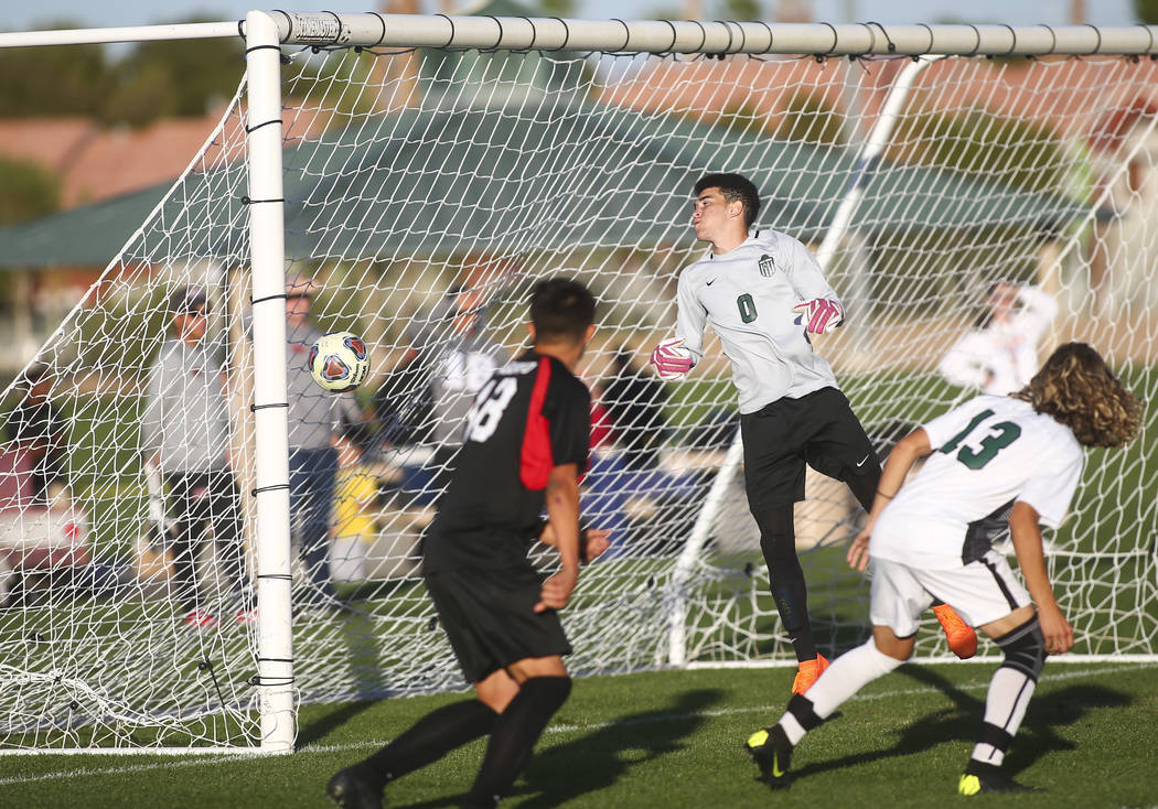 Las Vegas' Nathan Zamora, not pictured, heads the ball past Palo Verde's Yahir Diaz (0) to score a goal during the Mountain Region boys soccer semifinal match at the Bettye Wilson Soccer Complex i ...