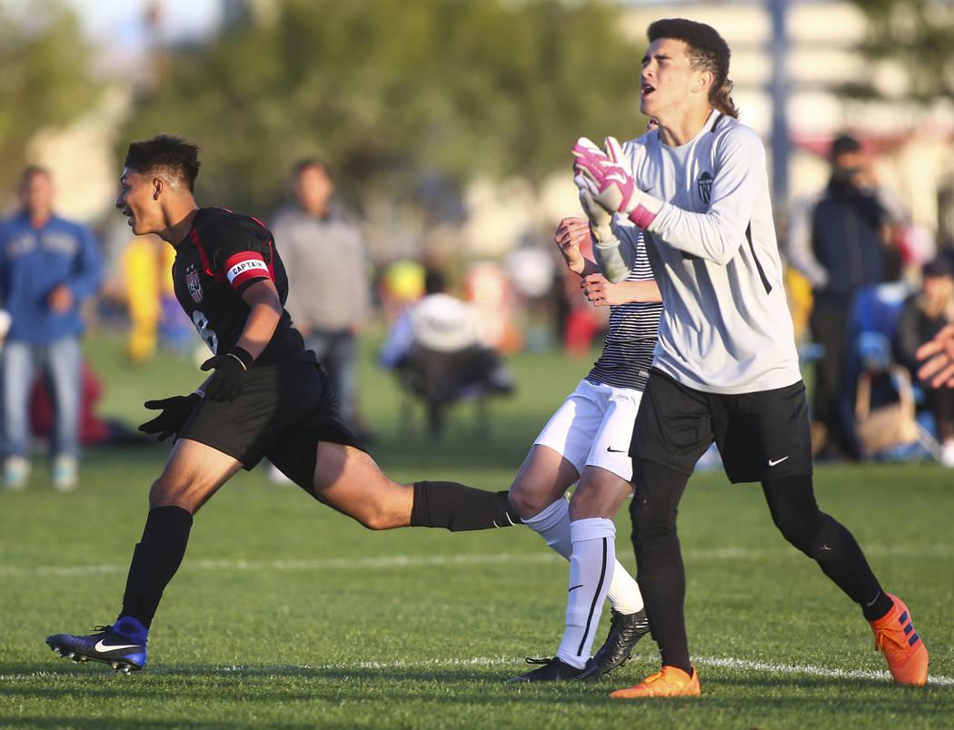Las Vegas' Daniel Rangel, left, scores a goal against Palo Verde during the Mountain Region boys soccer semifinal match at the Bettye Wilson Soccer Complex in Las Vegas on Thursday, Nov. 1, 2018. ...