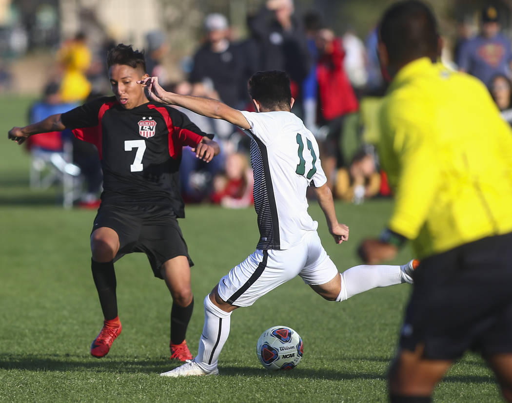 Palo Verde's Tyler Olenak (13) looks to kick the ball past Las Vegas' Luis Hernandez (7) during the Mountain Region boys soccer semifinal match at the Bettye Wilson Soccer Complex in Las Vegas on ...