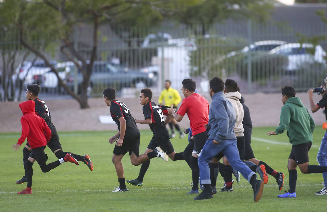 Las Vegas players celebrate their win over Palo Verde in the Mountain Region boys soccer semifinal match at the Bettye Wilson Soccer Complex in Las Vegas on Thursday, Nov. 1, 2018. Chase Stevens L ...