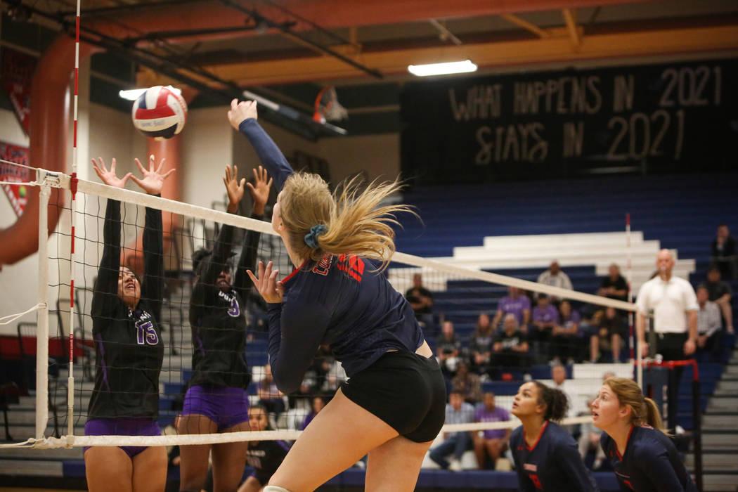 Coronado's Sasha Bolla hits the ball over the net as Durango's Anuhea Faitau, left, and Shakayla Scarbrough attempt to block it during the Desert Region girls volleyball semifinal at Coronado High ...