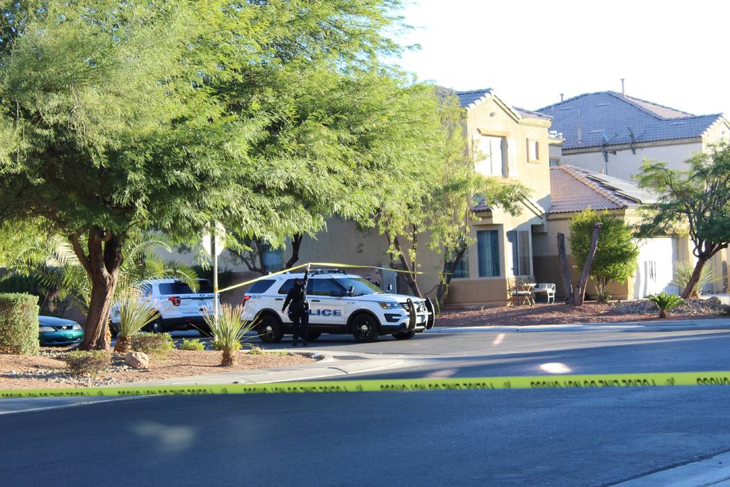 North Las Vegas police investigate on Friday, Nov. 2, 2018, after a fatal shooting Thursday night in the 6700 block of Courtney Michelle Street in North Las Vegas. An 11-year-old girl in the home ...
