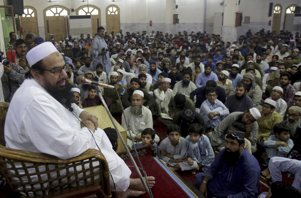 Pakistani cleric Hafiz Saeed, the founder of the outlawed Lashkar-e-Taiba group, which was blamed for the 2008 Mumbai attacks that killed 166 people, addresses at a mosque in Lahore, Pakistan, Thu ...