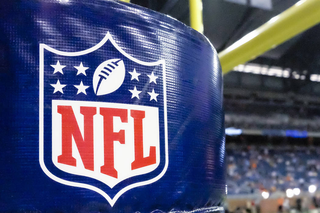 This Aug. 9, 2014 file photo shows an NFL logo on a goal post pad before a preseason NFL football game between the Detroit Lions and the Cleveland Browns at Ford Field in Detroit. (AP Photo/Rick O ...
