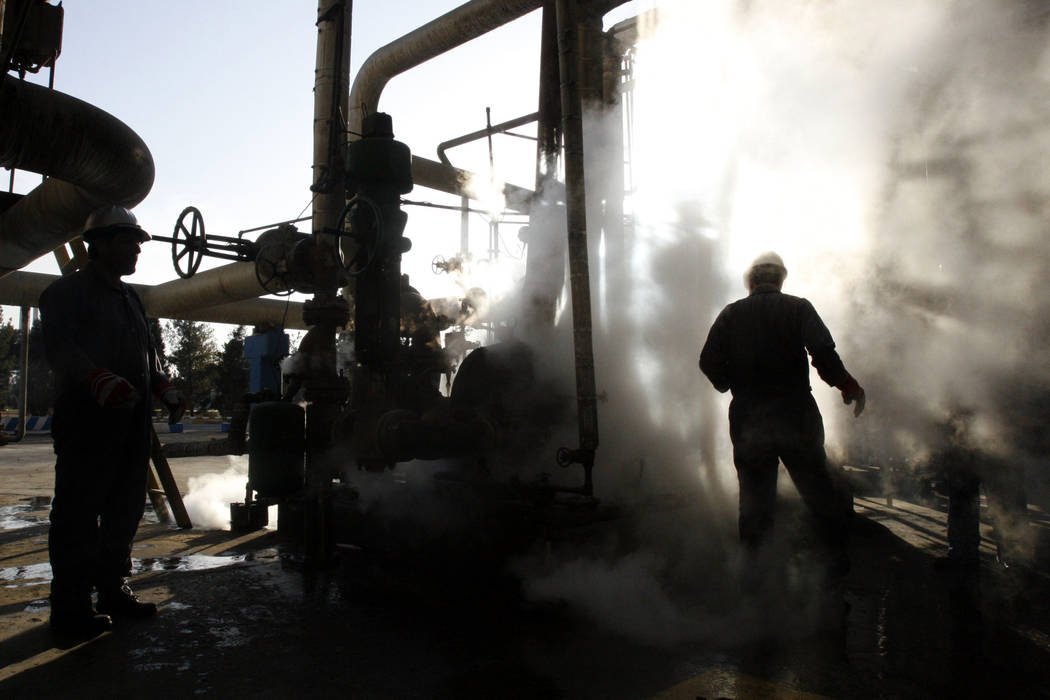 A worker repairs a part of a unit of the Tehran oil refinery in Iran, Nov. 17, 2007. Iran is preparing for the return of U.S. sanctions Nov. 5 that will hit its multibillion dollar oil exports. (V ...