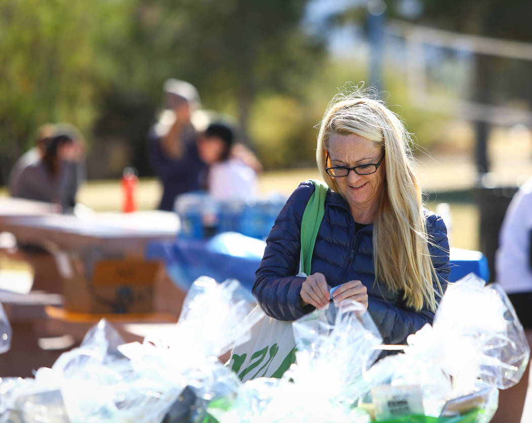 Guest speaker Jessica Lucas rips off tickets to enter into a raffle at the Las Vegas National Eating Disorder Association walk at Sunset Park in Las Vegas, Sunday, Nov. 11, 2018. Caroline Brehman/ ...