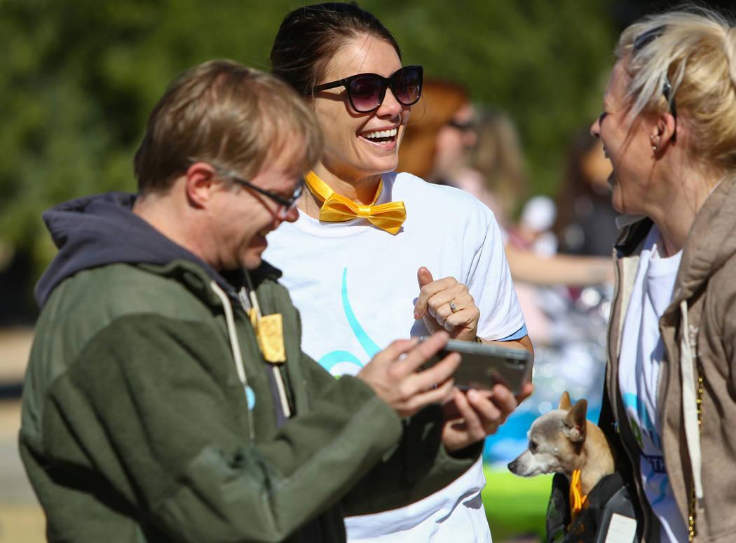 Paul Gordon, left, Lindsey Ricciardi and Allison Reich talk before the Las Vegas National Eating Disorder Association walk begins at Sunset Park in Las Vegas, Sunday, Nov. 11, 2018. Caroline Brehm ...