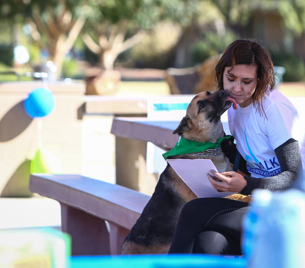 Jennifer Raymaker sits with her dog, Sophie, before the Las Vegas National Eating Disorder Association walk begins at Sunset Park in Las Vegas, Sunday, Nov. 11, 2018. Caroline Brehman/Las Vegas Re ...