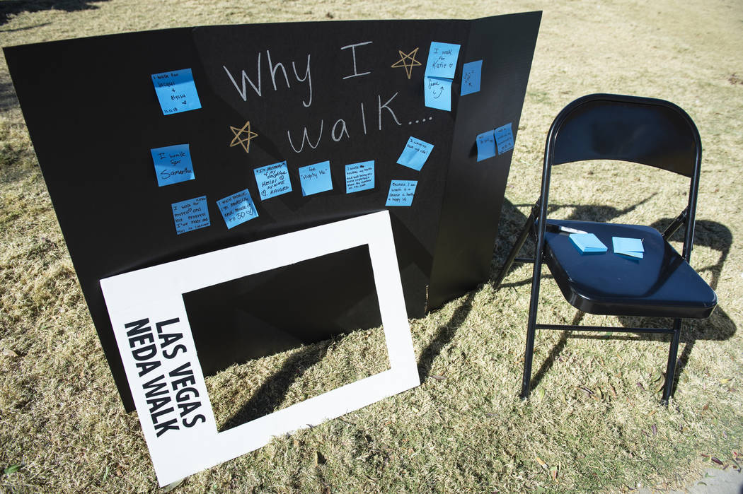 Attendees at the Las Vegas National Eating Disorder Association walk are encouraged to write their reasons for walking at Sunset Park in Las Vegas, Sunday, Nov. 11, 2018. Caroline Brehman/Las Vega ...