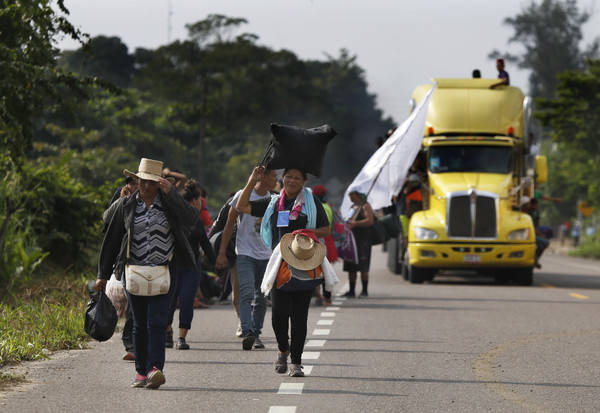 Central American migrants, part of the caravan hoping to reach the U.S. border, begin their morning trek, in Donaji, Oaxaca state, Mexico, Friday, Nov. 2, 2018. The migrants had already made a gru ...