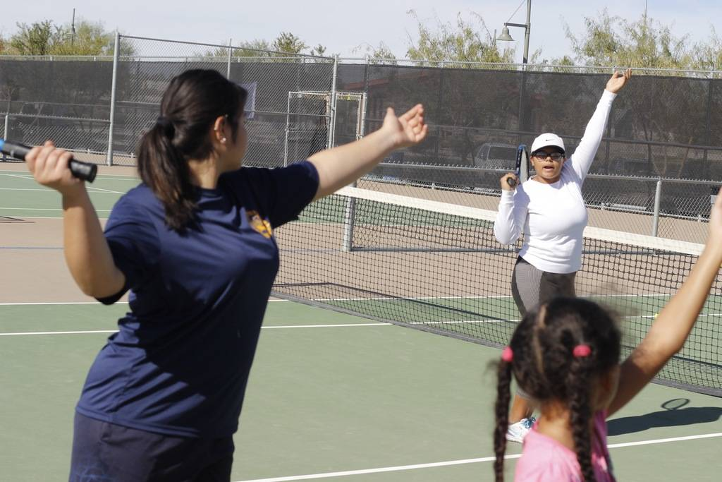 Atlantis Rivas follows the directions of instructor Veronica Palacios during tennis lessons at Craig Ranch Regional Park on Saturday. (Mia Sims/Las Vegas Review-Journal @miasims____)